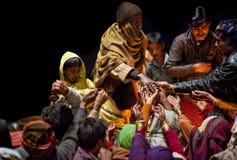 Prasad contribution in Varanasi. VARANASI - JANUARY 15: Prasad contribution to people during Ganga Aarti ceremony at Dashashwamedh Ghat on January 15, 2010 in Stock Image