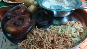Prasad Plate. Close up click of Indian traditional prasad plate including sweets and few snacks which is offered to the God on festivals stock images