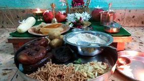 Prasad Plate. Close up click of Indian traditional prasad plate including sweets and few snacks which is offered to the God on festivals royalty free stock photo