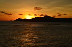 Praslin island. View of pralin island from La Digue island at the sunset Stock Image