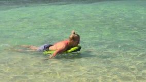 Praslin Seychelles sunbathing in the sea stock video footage
