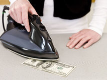 prasowanie pieniądze Zdjęcie Royalty Free