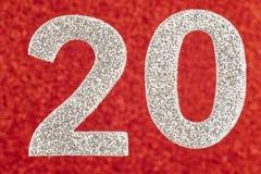 Prata do número vinte sobre um fundo vermelho anniversary Fotografia de Stock