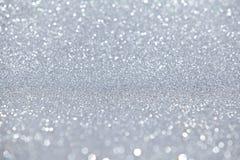 A prata Sparkles fundo claro Imagens de Stock