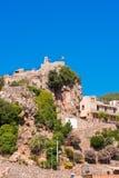 Pratdip山镇在西班牙 复制文本的空间 查出在蓝色背景 垂直 免版税库存图片