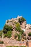 Pratdip山镇在西班牙 复制文本的空间 查出在蓝色背景 垂直 库存照片