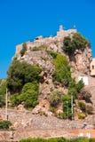 Pratdip山镇在西班牙 复制文本的空间 查出在蓝色背景 垂直 免版税库存照片