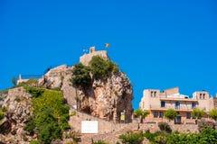 Pratdip山镇在西班牙 复制文本的空间 查出在蓝色背景 库存图片