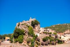 Pratdip山镇在西班牙 复制文本的空间 查出在蓝色背景 免版税库存照片