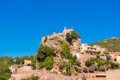 Pratdip山镇在西班牙 复制文本的空间 查出在蓝色背景 免版税图库摄影