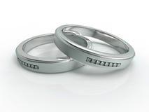 Prateie com anéis de casamento dos diamantes Imagem de Stock Royalty Free