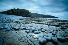 Prateleiras da rocha na baía de Dunraven Foto de Stock