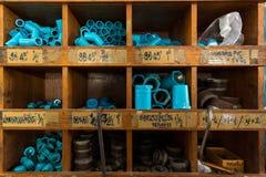 Prateleiras do PVC na loja de DIY Fotografia de Stock Royalty Free