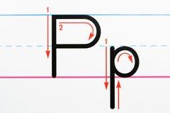 Pratica di scrittura della lettera. Fotografia Stock