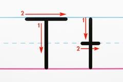 Pratica di scrittura di alfabeto. Immagini Stock