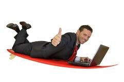 Praticando il surfing nella rete Fotografia Stock