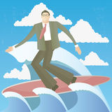 Praticare il surfing dell'uomo di affari Fotografie Stock