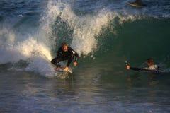 Praticare il surfing il cuneo Fotografia Stock