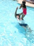Praticare il surfing umano Fotografia Stock