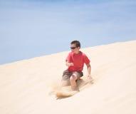 Praticare il surfing una duna Fotografie Stock Libere da Diritti