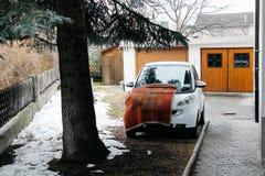 Prato allo Stelvio, Italy - 03 24 2013: View of the streets of Italian Prato allo Stelvio. a car in the yard. Prato allo Stelvio, Italy - 03 24 2013: a car in stock images