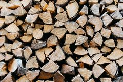 The texture of felled trees, a place to store firewood, natural background royalty free stock images