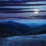 Prato in alte montagne alla notte Fotografie Stock