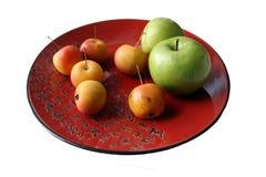 Prato chinês com maçãs Fotos de Stock