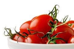 Prato com tomates de cereja Fotografia de Stock