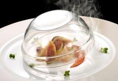 Prato de peixes, lagosta e fumo dos figos Imagem de Stock