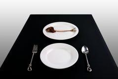 Prato e Fishbone na tabela Imagem de Stock Royalty Free