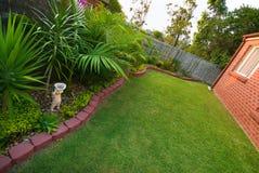 Prato inglese e giardino fotografie stock