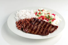 Prato típico de Brasil, de arroz e de feijões Fotos de Stock