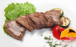 Pratos da carne do assado imagem de stock