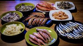 Pratos de peixes na tabela Fotografia de Stock Royalty Free