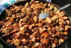 Pratos fritados da carne de porco foto de stock