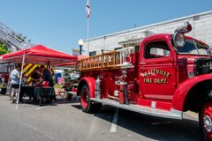 Prattville Fire Department booth. Prattville, Alabama, USA - May 12, 2018: Prattville Fire Department displays an antique fire truck near their booth at the 2018 royalty free stock photos