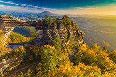 Pravcicka Gate in autumn colors, Bohemian Saxon Switzerland, Czech Republic. Sunset stock image