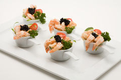 Prawn appetizer with caviar. In little bowls royalty free stock image