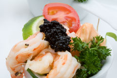 Prawn appetizer with caviar. In little bowls stock photography