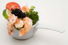 Prawn appetizer with caviar. In a little bowl stock photos