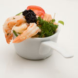 Prawn appetizer with caviar. In little bowls royalty free stock photography