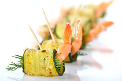Prawn appetizers. Delicious rolls of fried zucchini slices and prawns with dill stock photography