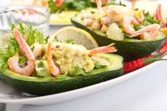 Prawn and Avocado Salad. Stylish Prawn, Lemon and avocado salad Served in Fresh Avocado Half Stock Photo