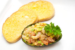 Prawn and avocado salad with garlic bread Stock Photography