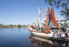 Prawn boat with nets drying. Royalty Free Stock Photo