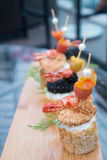 Prawn canapes lined up on a serving platter Stock Images