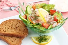 Prawn cocktail. A prawn cocktail appetizer with salad and marie rose sauce. Served with wholemeal bread Royalty Free Stock Image