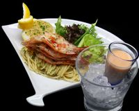 Prawn Cocktail with Pasta Salad. Served with Cocktail Dressing and accompanied with MIx Salad and Lemon Royalty Free Stock Image