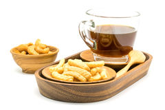Prawn cracker and a cup of black coffee in a wooden tray with sa Royalty Free Stock Images